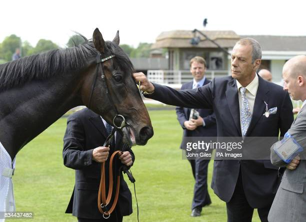 Trainer Henry Cecil pats his horse Twice Over after it was the beaten favourite in the Dante Stakes at York Racecourse York