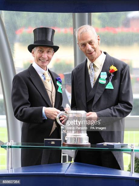 Trainer Henry Cecil with Charlie Watts after his horse Father Time won the King Edward VII Stakes at Ascot Racecourse Berkshire
