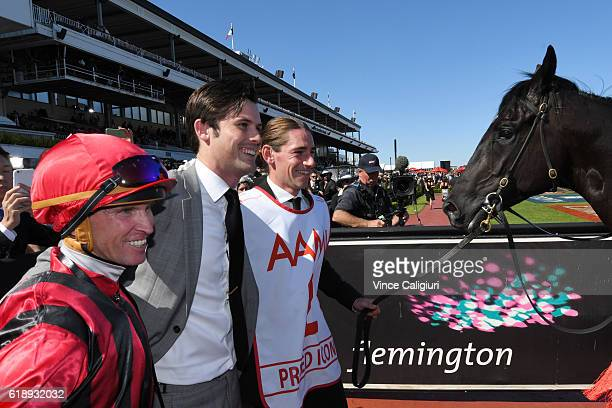 Trainer James Cummings and Glyn Schofield and strapper after Prized Icon won Race 7 AAMi Victoria Derby on Derby Day at Flemington Racecourse on...