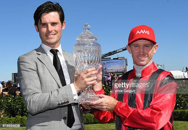 Trainer James Cummings and Glyn Schofield pose with trophy after Prized Icon won Race 7 AAMi Victoria Derby on Derby Day at Flemington Racecourse on...