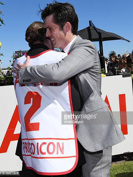 Trainer James Cummings hugs strapper after Prized Icon won Race 7 AAMi Victoria Derby on Derby Day at Flemington Racecourse on October 29 2016 in...
