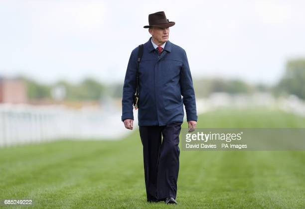 Trainer John Gosden on the course during Starlight Charity Raceday at Newbury Racecourse