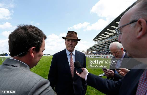 Trainer John Gosden tells the press that Golden Horn will not run at Ascot racecourse on July 25 2015 in Ascot England