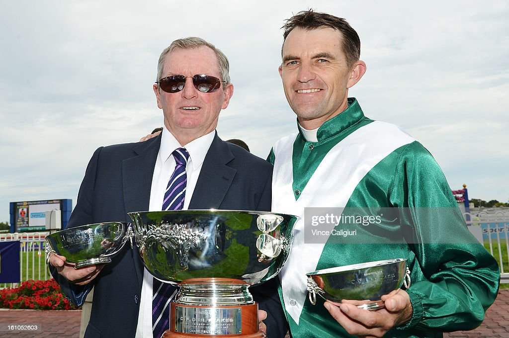Trainer John Hawkes and Dwayne Dunn pose with the Sportingbet C.F.Orr Stakes trophy during Melbourne Racing at Caulfield Racecourse on February 9, 2013 in Melbourne, Australia.