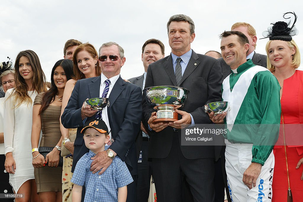 Trainer John Hawkes, Peter Orton and Dwayne Dunn pose with the Sportingbet C.F.Orr Stakes trophy with connections during Melbourne Racing at Caulfield Racecourse on February 9, 2013 in Melbourne, Australia.