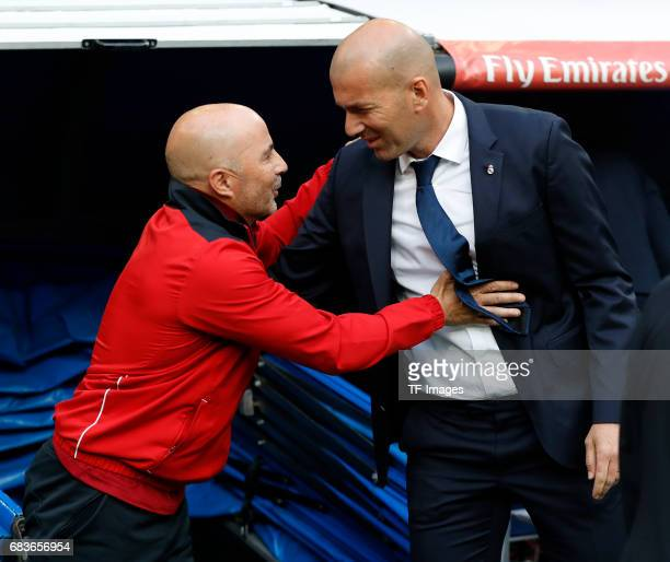 Trainer Jorge Sampaoli of Sevilla speak with Trainer Zinedine Zidane of Real Madrid during the La Liga match between Real Madrid CF and Sevilla CF at...