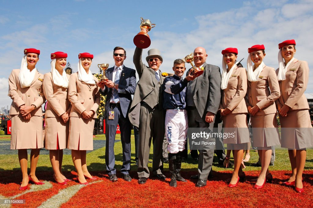 Trainer Joseph O'Brien, owner Lloyd Williams and jockey Corey Brown celebrate after winning race 7, the Emirates Melbourne Cup with their horse Rekindling on Melbourne Cup Day at Flemington Racecourse on November 7, 2017 in Melbourne, Australia.