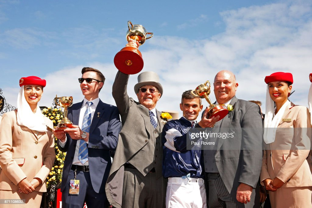 Trainer Joseph O'Brien, owner Lloyd Williams, jockey Corey Brown and Emirates Divisional Vice President Barry Brown celebrate after winning race 7, the Emirates Melbourne Cup with their horse Rekindling on Melbourne Cup Day at Flemington Racecourse on November 7, 2017 in Melbourne, Australia.