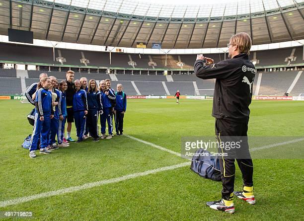 Trainer Juergen Klopp of Borussia Dortmund take pictures from soccer girl team BerlinLichterfelde with Marco Reus of Borussia Dortmund during a...