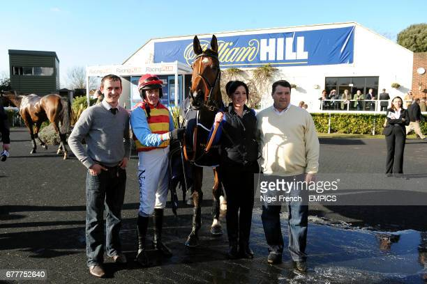 Trainer Kieran Burke and jockey Barry Geraghty with Hunt Ball in the winners enclosure after winning The William Hill App 25 SignUp Bonus Handicap...
