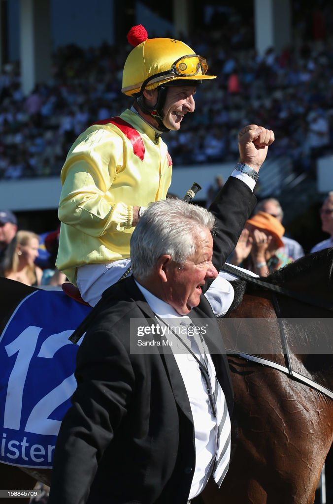 Trainer Lee Somervell celebrates as he brings jockey Jason Jago and Fleur De Lune back to the scale after winning the Sistema Railway Stakes at Ellerslie Racecourse on January 1, 2013 in Auckland, New Zealand.