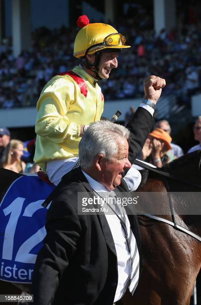 Trainer Lee Somervell celebrates as he brings jockey Jason Jago and Fleur De Lune back to the scale after winning the Sistema Railway Stakes at...