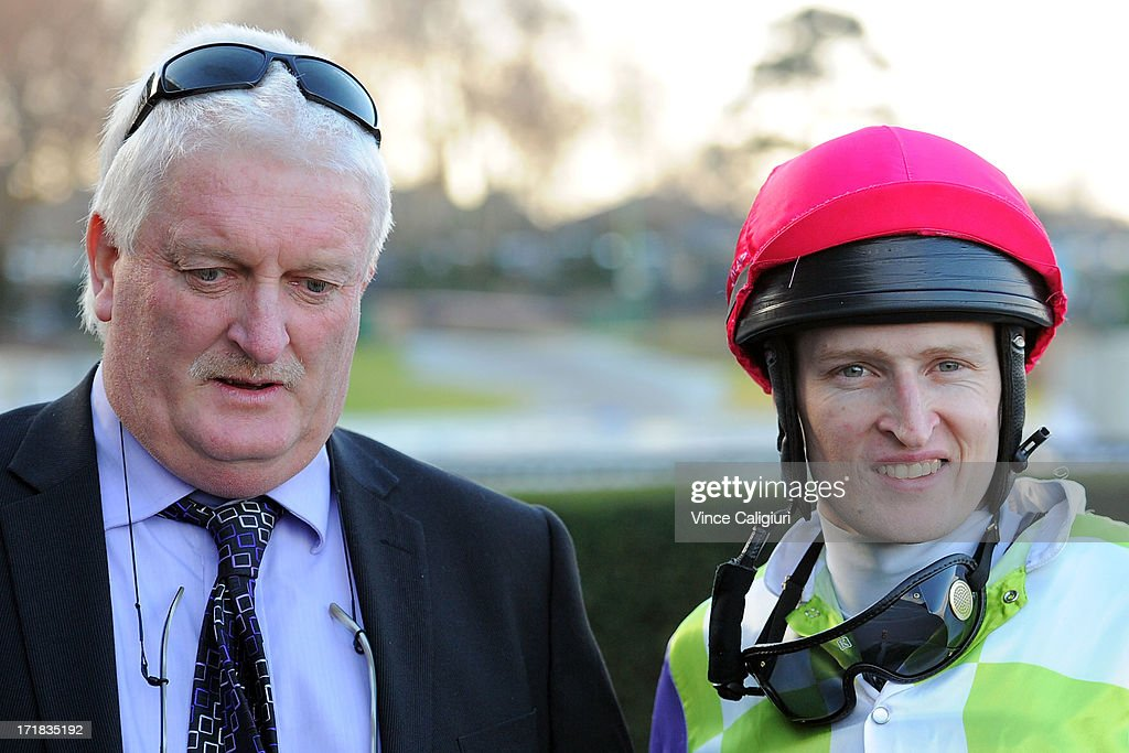 Trainer Leon Wells and Craig Newitt after winning the Programmed Property Services Handicap during Melbourne Racing at Moonee Valley Racecourse on June 29, 2013 in Melbourne, Australia.