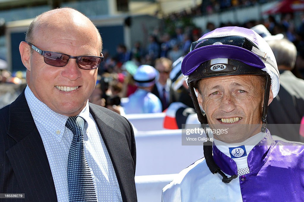 Trainer Liam Birchley and Damian Browne pose for photo after Liesele won the Carlton Draught Alinghi Stakes during Caulfield Cup day at Caulfield Racecourse on October 19, 2013 in Melbourne, Australia.