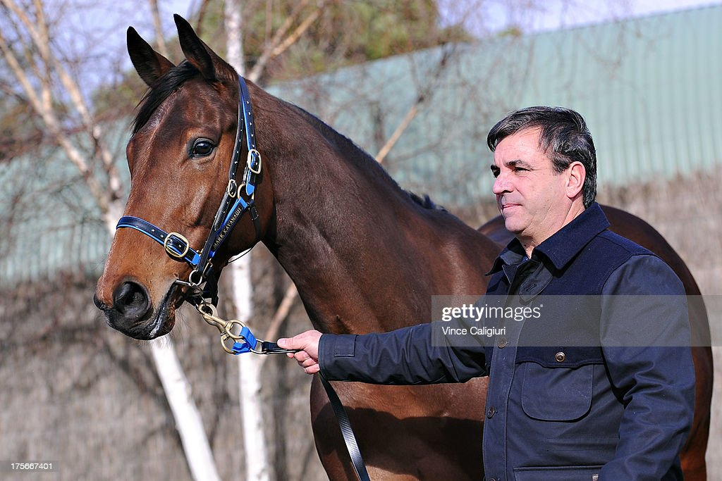 Trainer Mark Kavanagh poses for photo with Super Cool at todays announcement of 2013 Spring Carnival nominations at Flemington Racecourse on August 6, 2013 in Melbourne, Australia.