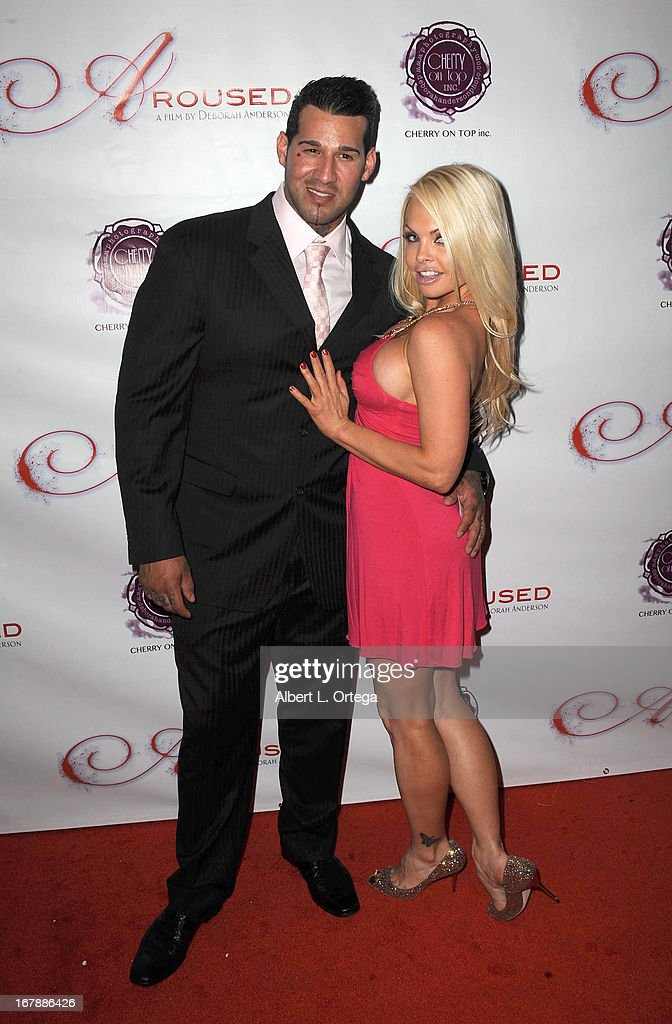 Trainer Michael Giovanni and adult film actress <a gi-track='captionPersonalityLinkClicked' href=/galleries/search?phrase=Jesse+Jane&family=editorial&specificpeople=2103220 ng-click='$event.stopPropagation()'>Jesse Jane</a> arrives for the Premiere Of 'Aroused' held at Landmark Nuart Theatre on May 1, 2013 in Los Angeles, California.