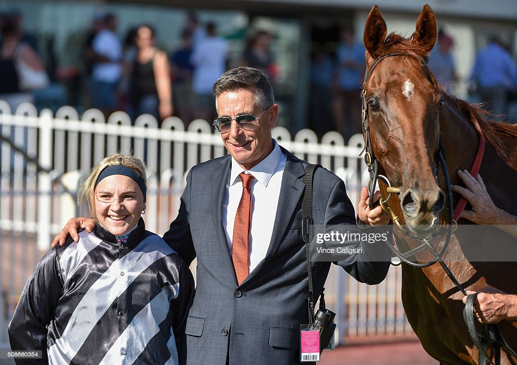 Trainer Mick Kent poses with Jackie Beriman after riding Written to win Race 9 during Melbourne Racing at Caulfield Racecourse on February 6, 2016 in Melbourne, Australia.