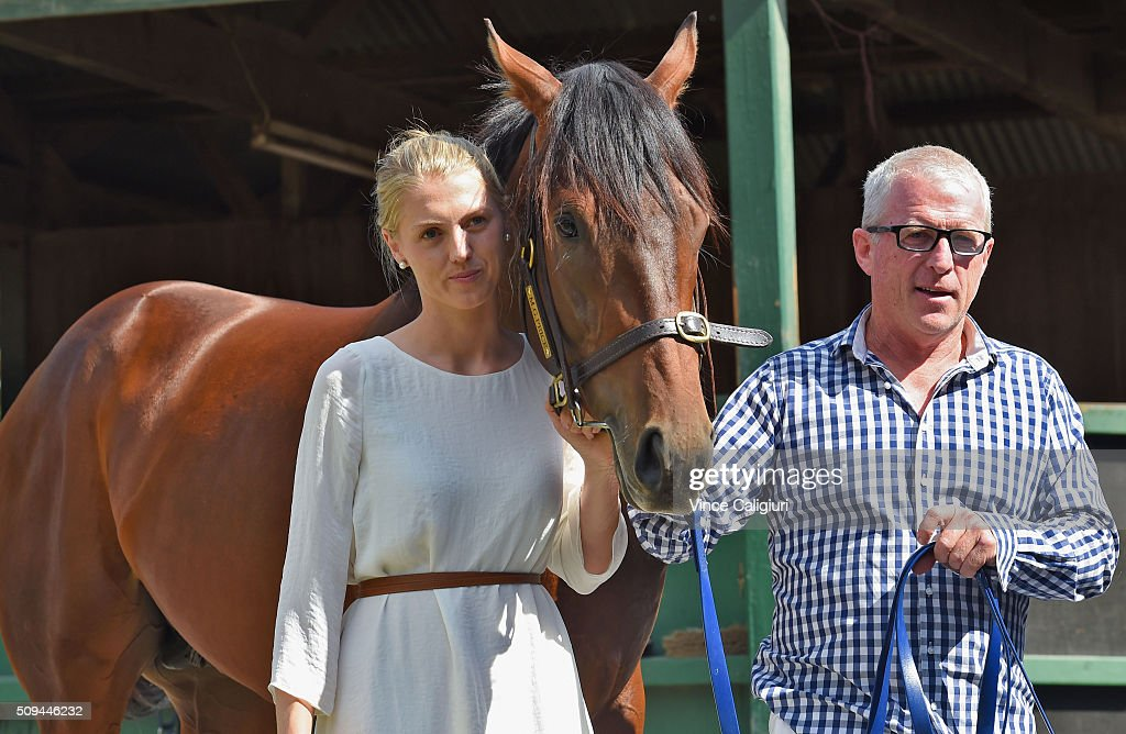 Trainer Mick Price and daughter Kelly Price pose with Blue Diamond chance Flying Artie during the launch of 'Relaxed Racing' carnival at Caulfield Racecourse on February 11, 2016 in Melbourne, Australia.