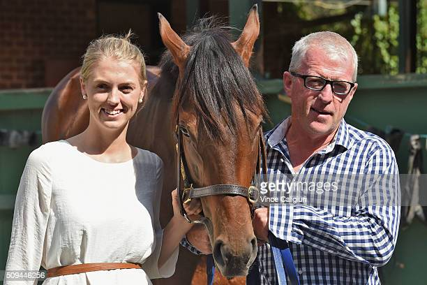 Trainer Mick Price and daughter Kelly Price pose with Blue Diamond chance Flying Artie during the launch of 'Relaxed Racing' carnival at Caulfield...