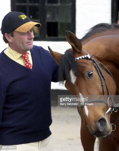 Trainer Nicky Henderson at his stables in Lambourn with Lord Joshua one of his entries for the JCB Triumph Hurdle at the National Hunt Festival at...