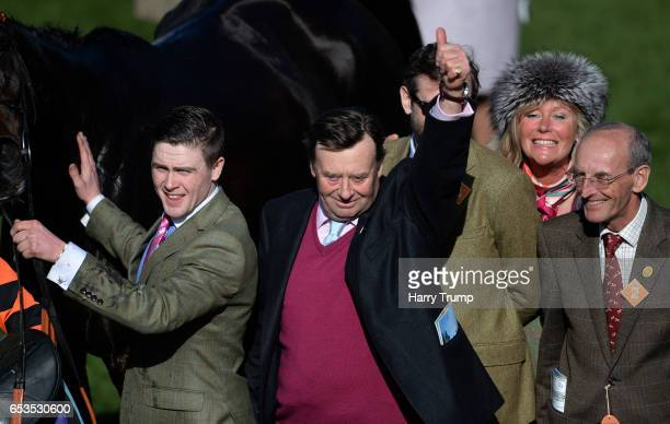 Trainer Nicky Henderson celebrates after victory for Might Bite in the RSA Novices Steeple Chase during Ladies Day of the Cheltenham Festival at...