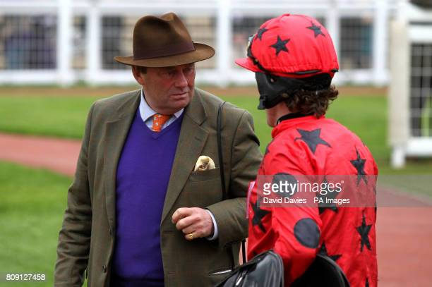 Trainer Nicky Henderson chats with Tony McCoy in the parade ring during day two of The April Meeting at Cheltenham Racecourse