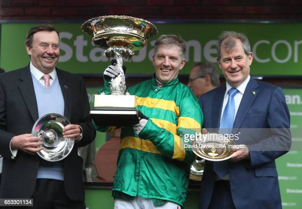 Trainer Nicky Henderson Jockey Noel Fehily with the Stan James Champion Hurdle Challenge Trophy and owner John McManus during Champion Day of the...