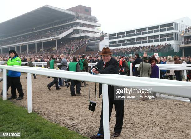 Trainer Nicky Henderson watches from the rail on St Patrick's Day during the Cheltenham Festival