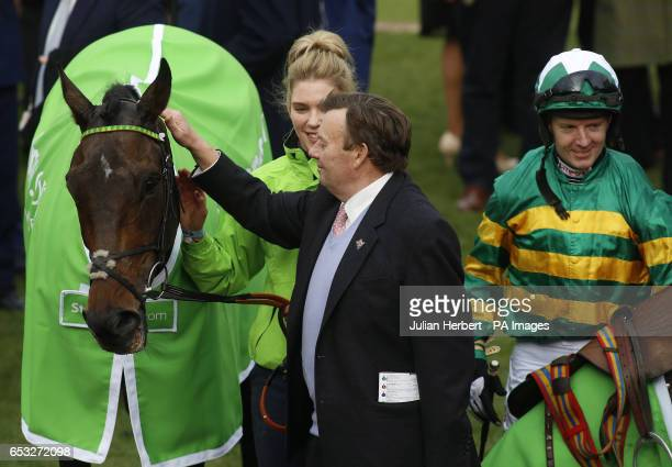 Trainer Nicky Henderson with Buveur D'Air and jockey Noel Fehily after winning The Stan James Champion Hurdle Race run during Champion Day of the...