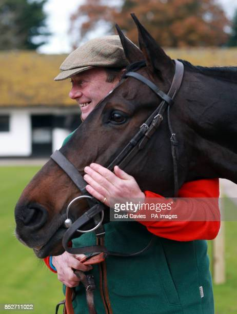 Trainer Nicky Henderson with Long Run during a stable visit at Seven Barrows Lambourn