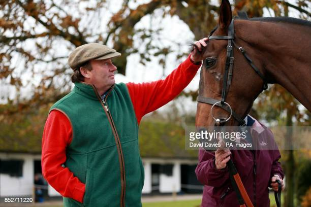 Trainer Nicky Henderson with My Tent Or Yours during a stable visit at Seven Barrows Lambourn