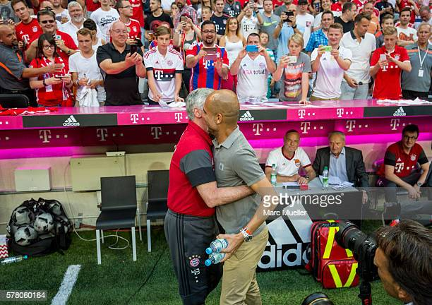 Trainer of Bayern Munich Carlo Ancelotti and Pep Guardiola trainer of Manchester City are seen during a friendly match between Bayern Munich and...