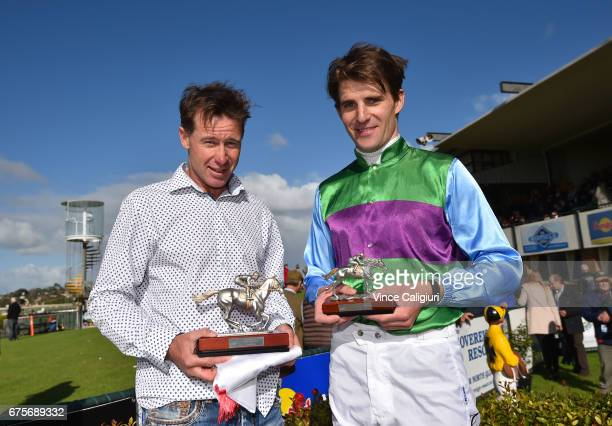 Trainer Patrick Payne poses with Steven Pateman after Zed Em won Race 6 Brierly Steeplechase during the Warrnambool Racing Carnival on May 2 2017 in...