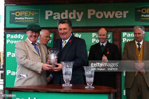 Trainer Paul Nicholls accepts a trophy after winning the Paddy Power Mobile Intermediate Handicap Hurdle with Rangitoto