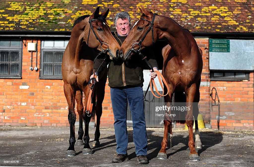Trainer <a gi-track='captionPersonalityLinkClicked' href=/galleries/search?phrase=Paul+Nicholls+-+Entra%C3%AEneur+d%27%C3%A9quitation&family=editorial&specificpeople=8009047 ng-click='$event.stopPropagation()'>Paul Nicholls</a> poses with Dodging Bullets(L) and Silviniaco Conti(R) at Manor Farm Stables on February 9, 2016 in Ditcheat, England.
