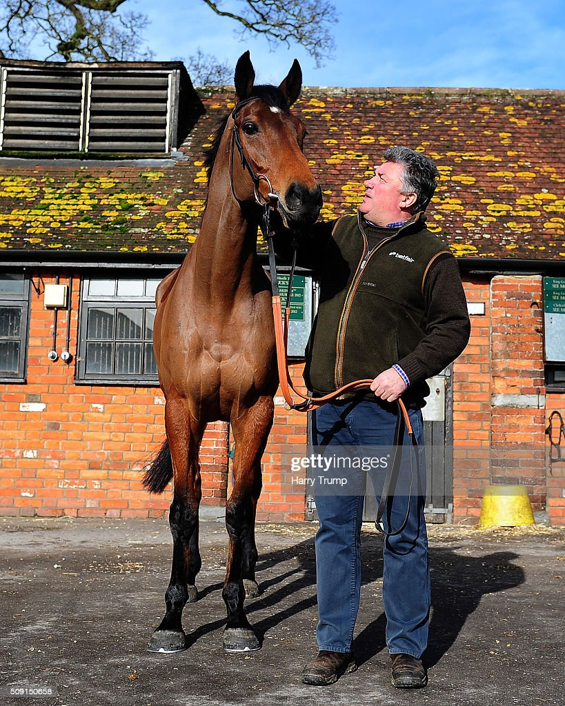 Trainer Paul Nicholls poses with Dodging Bullets at Manor Farm Stables on February 9, 2016 in Ditcheat, England.