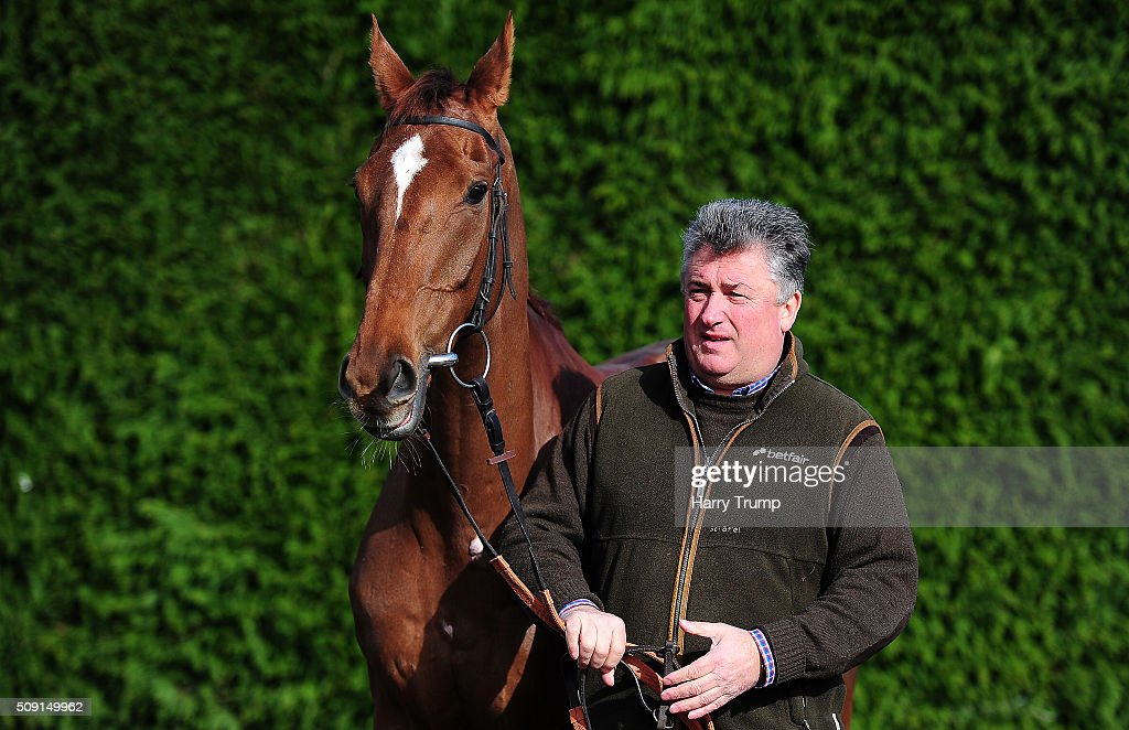 Trainer <a gi-track='captionPersonalityLinkClicked' href=/galleries/search?phrase=Paul+Nicholls+-+Horse+Trainer&family=editorial&specificpeople=8009047 ng-click='$event.stopPropagation()'>Paul Nicholls</a> poses with Silviniaco Conti at Manor Farm Stables on February 9, 2016 in Ditcheat, England.