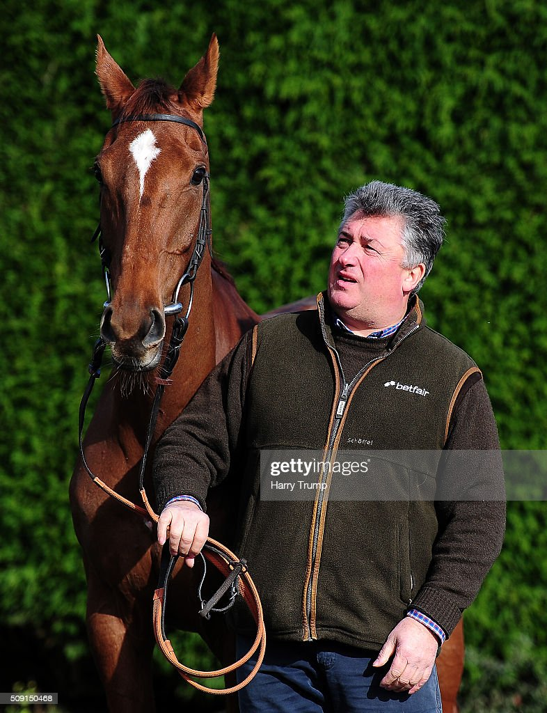 Trainer <a gi-track='captionPersonalityLinkClicked' href=/galleries/search?phrase=Paul+Nicholls+-+Entra%C3%AEneur+d%27%C3%A9quitation&family=editorial&specificpeople=8009047 ng-click='$event.stopPropagation()'>Paul Nicholls</a> poses with Silviniaco Conti at Manor Farm Stables on February 9, 2016 in Ditcheat, England.