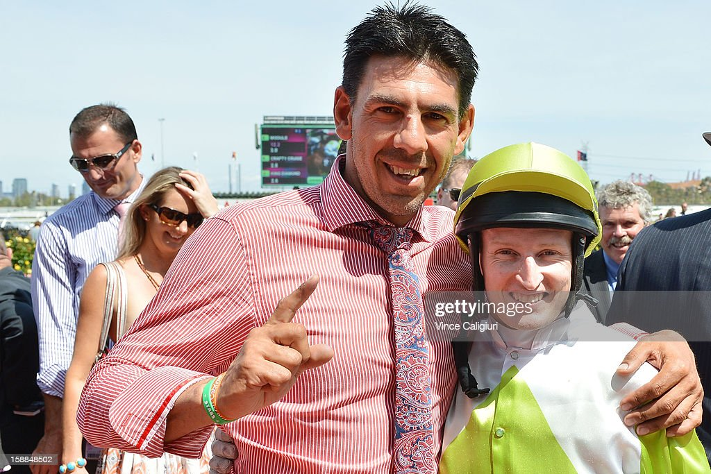 Trainer Peter Gelagotis and Craig Newitt after winning the Bagot Handicap during Melbourne Racing at Flemington Racecourse on January 1, 2013 in Melbourne, Australia.