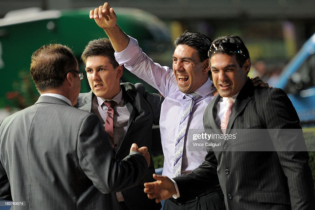 Trainer Peter Gelagotis (2nd from R) celebrates after winning the Sportingbet Alister Clark Stakes during Melbourne racing at Moonee Valley Racecourse on March 15, 2013 in Melbourne, Australia.