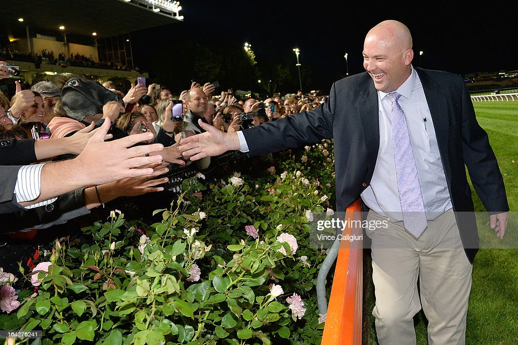 Trainer Peter Moody celebrates with the crowd after Black Caviar won her 24th straight win in the Hacer Group William Reid Stakes during Melbourne racing at Moonee Valley Racecourse on March 22, 2013 in Melbourne, Australia.