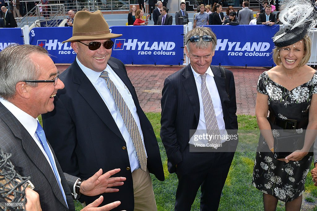 Trainer Peter Moody (2nd from L) chats with owners of Black Caviar after her exhibition gallop in between races at Caulfield Racecourse on February 2, 2013 in Melbourne, Australia.