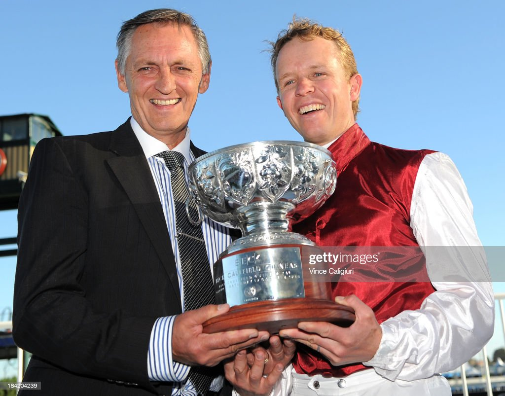 Trainer Peter Snowden and Kerrin McEvoy pose with the trophy after winning the Beck Caulfield Guineas with Long John during Melbourne Racing at Caulfield Racecourse on October 12, 2013 in Melbourne, Australia.
