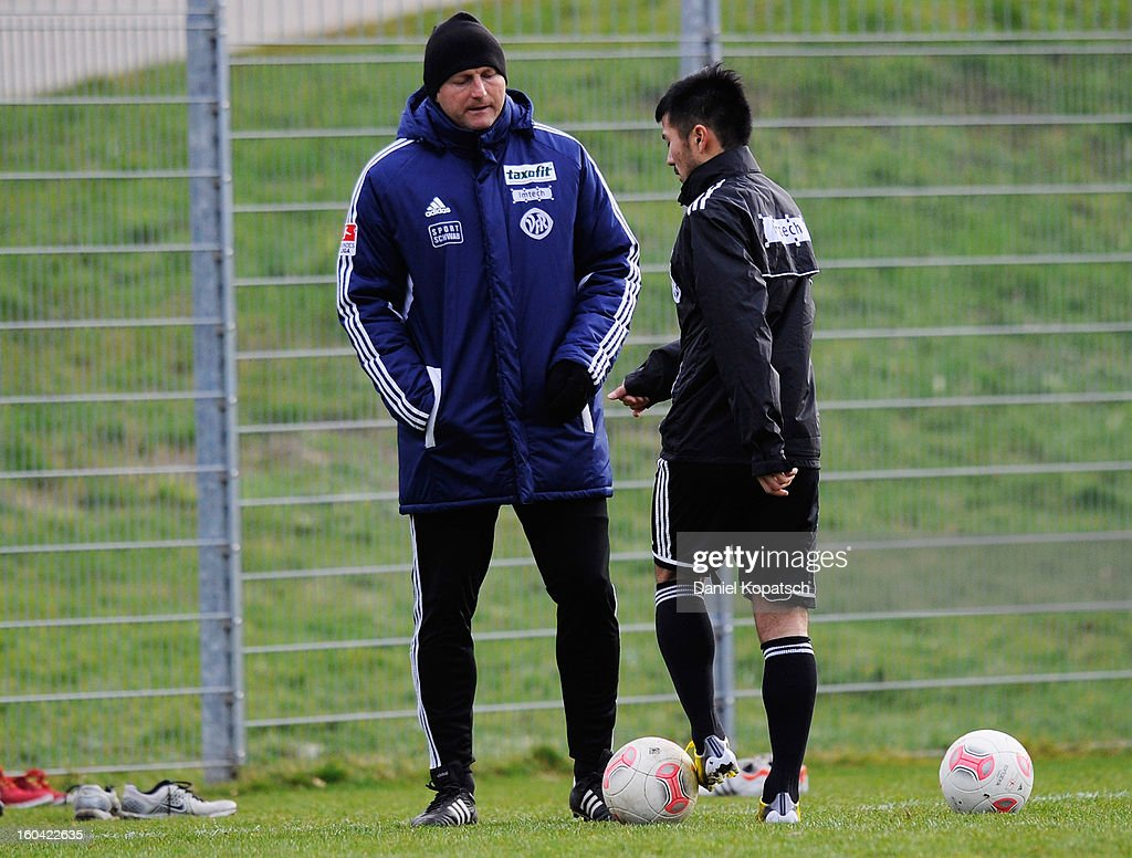 Trainer Ralph Hasenheuttl (L) speaks with Takuma Abe during the training session of VfR Aalen on January 31, 2013 in Aalen, Germany.