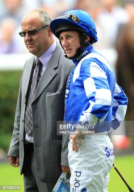 Trainer Richard Fahey chats with his jockey Paul Hanagan