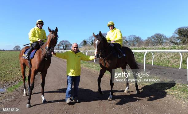 Trainer Richard Fahey with Gabrial's Kaka ridden by Barry McHugh and Hi There ridden by Tony Hamilton during the stable visit to Mews House Stables...