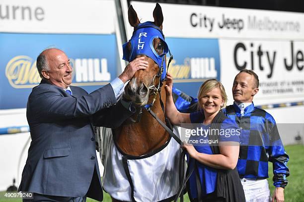 Trainer Robert Heathcote poses with Buffering after winning Race 7 the City Jeep Moir Stakes during Melbourne Racing at Moonee Valley Racecourse on...