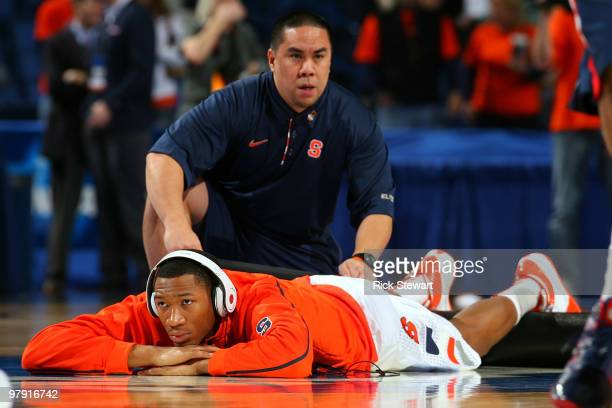 Trainer Ryan Cabiles works on Wes Johnson of the Syracuse Orange before his game against the Gonzaga Bulldogs during the second round of the 2010...