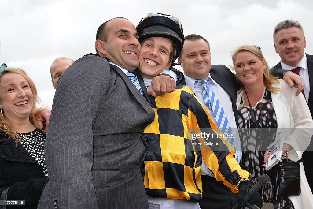 Trainer Saab Hasan hugs Chris Symons after winning aboard Shoreham in The Sofitel during Melbourne racing at Flemington Racecourse on September 7, 2013 in Melbourne, Australia.