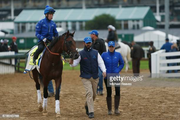 Trainer Saaed bin Suroor leads Thunder Snow back to the barn area after morning training prior to the 143rd Kentucky Derby at Churchill Downs on May...